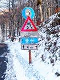 Warning Sign Road Snow Mountain road. Warning Sign Road Snow on Mountain road Royalty Free Stock Photo