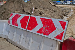 Warning sign on the rotational direction. Of the plastic road barriers Stock Photo