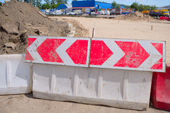 Warning sign on the rotational direction. Of the plastic road barriers Stock Photography