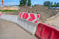 Warning sign on the rotational direction. Of the plastic road barriers Royalty Free Stock Photos