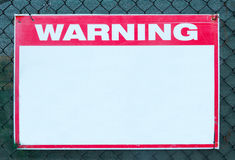 Warning Sign safety caution with blank white message at construction site grid boundary. Royalty Free Stock Photo