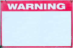 Warning Sign safety caution with blank white message at construction site grid boundary. Stock Photos
