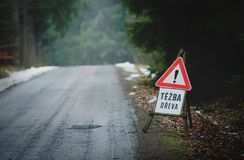 Warning Sign and a Sign Saying in Czech Language: Tezba dreva in English: Attention Logging Standing on the Road in Forest. Warning Sign and a Sign Saying in royalty free stock images