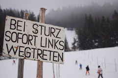 Warning sign on ski slope Stock Photos