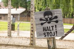 Warning sign stop in Auschwitz, a polish Nazi concentration ca Royalty Free Stock Image