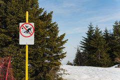 Warning sign. Stop skiing.Warning sign on mountain Royalty Free Stock Photography