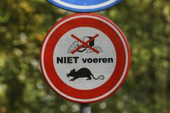 Feeding of waterfowl not allowed due to rat problem. Stock Image