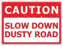 """Caution Dusty Road. A warning sign with the text """"Caution Slow Down Dusty Road Royalty Free Stock Photos"""