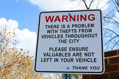 Warning sign about theft in the area stock photography