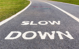 Warning sign to slow down marked on street, safety concept. Royalty Free Stock Images