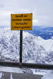 Warning sign on top of mountain Royalty Free Stock Photography