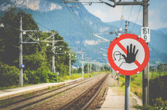 Warning Sign At A Train Station Royalty Free Stock Image