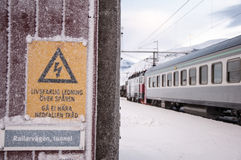 Warning sign in train station in Lapland Stock Image