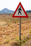 Warning sign for walking along the road Royalty Free Stock Photography