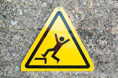 Warning sign .Watch your steps not to fall stock photography