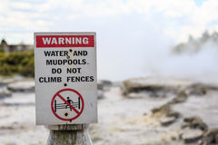 Warning sign for water and mudpools in Rotorua, New Zealand Royalty Free Stock Images