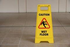 Warning Sign Of Wet Floor. Yellow Warning Sign Warning Of Slippery Wet Floor Stock Photo