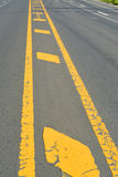 Warning sign of white and yellow color on road. Exemplary warning sign of white and yellow color on road stock images