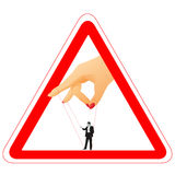 Warning sign with woman`s arm holding a businessma Royalty Free Stock Photos
