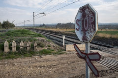 Warning sign worn of level crossing without barriers Royalty Free Stock Photos