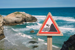 Warning signal on the coast. Warning signal about the risk of falling into the cliffs Royalty Free Stock Image