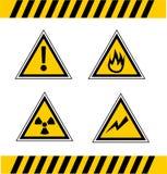 Warning signals. Triangular yellow signs that warn dangers Royalty Free Stock Photos