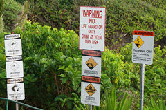 Warning signals in Waianapanapa State park Stock Images