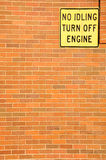 Warning signboard on the brick wall. Royalty Free Stock Images