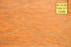 Warning signboard on the brick wall. Stock Photo
