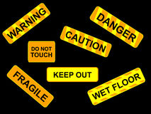 Warning signes illustration. Various warning signs isolated on black background Stock Image