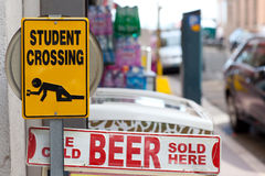 Warning signs. Warning sign with text Drunken students crossing and Beer sold here Stock Image
