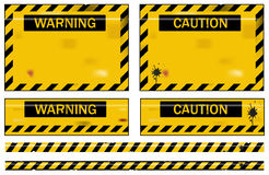 Warning signs. Old worn grungy yellow and black warning signs Stock Images