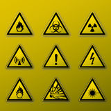 Warning signs. Graphic of nine yellow warning signs Stock Image