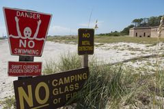 Warning signs along a beach road in Dauphin Island, Alabama. Several warning signs are posted along a beach road on Dauphin Island in Alabama which is located in Royalty Free Stock Images
