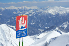 Warning signs of avalanche on slopes Stock Images