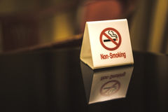 The warning signs banning smoke on the table. Stock Images