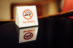 The warning signs banning smoke on the table. Royalty Free Stock Photography
