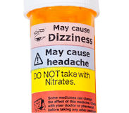 Warning signs on bottle of rx drugs Stock Image