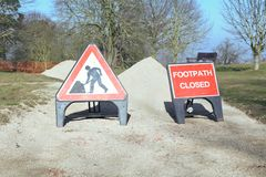 Warning signs - digging and footpath closed - to inform people of danger ahead. In park royalty free stock photography