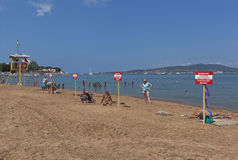 Warning signs with the inscription Warning! No swimming! Danger to life on the beach in Gelendzhik Stock Photography