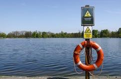 Warning signs in Kensington gardens Royalty Free Stock Image
