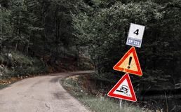 Warning signs in mountain road royalty free stock photos