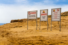 Warning signs near the Azure Window, Malta. Warning signs near the Azure Window in Malta Royalty Free Stock Images