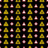 Warning signs pattern - triangle warning, danger signs. Warning  signs pattern, yellow and red warning signs patterns on black Royalty Free Stock Photography