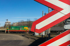 Warning signs at railway crossing with the train Royalty Free Stock Image