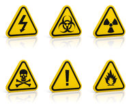 Warning signs set. Set of yellow triangle warning signs. Isolated on white. Glossy floor Stock Photos