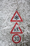 Warning signs shows danger of ice and snow at street Royalty Free Stock Photo