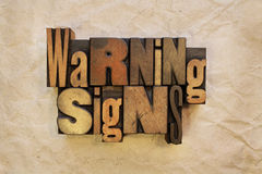 Warning Signs. The words Warning Signs written in vintage wood letterpress type Royalty Free Stock Photography