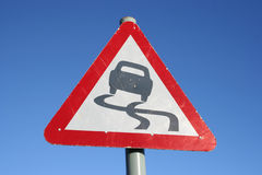 Warning slippery road sign Royalty Free Stock Photography