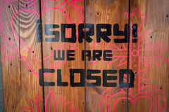 Warning, sorry we are closed. Warning with words sorry we are closed on wood Royalty Free Stock Photos